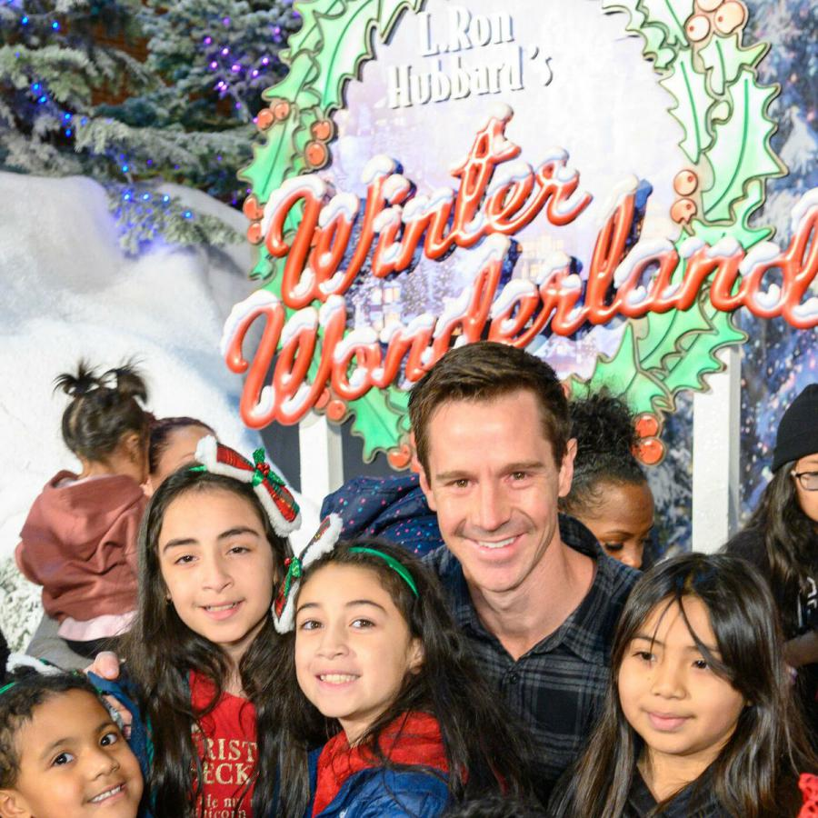 Actor Jason Dohring gave out toys to kids at the opening of L. Ron Hubbard's Winter Wonderland.