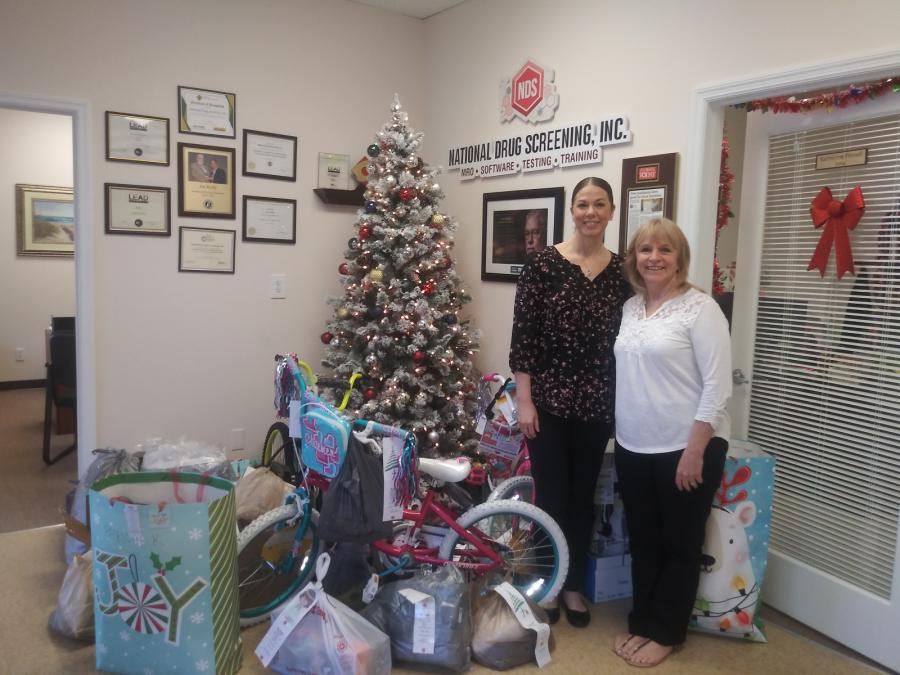 Julie Floriano and Shannon Kikendall coordinator of the NDS Christmas Giving Team