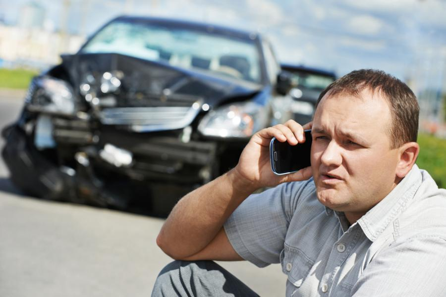 Auto Accident Lawyer Philadelphia pa car Image of car accident damage and man on cell phone HGSKlawyers.com