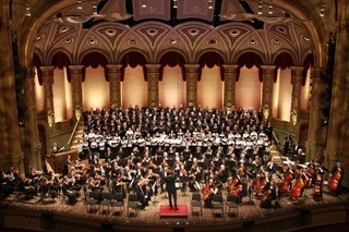 Musicians perform with the West Coast Symphony Orchestra on the Orpheum Theatre stage