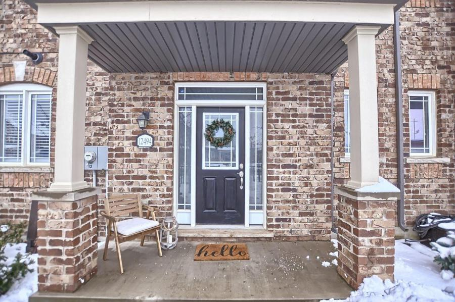 Charming entrance of the townhome for sale.