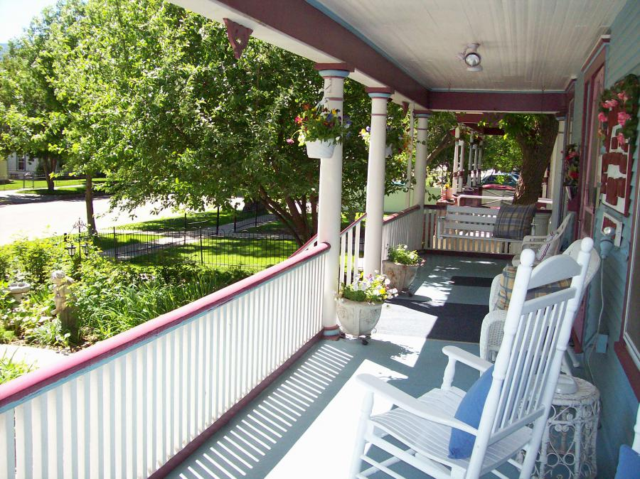 The Victorian verandah offers rocking chairs and old-fashioned porch swings with a view of the garden