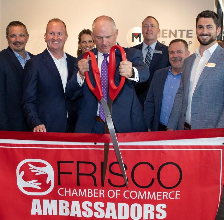 Mente Group President and CEO Brian Proctor (C) cuts the ribbon to the company's new worldwide headquarters in Frisco's prestigious North Dallas' HALL Park.