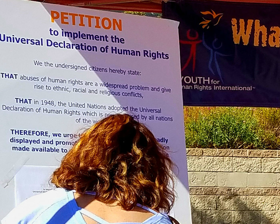 Visitors to the booth were invited to sign a petition to make it mandatory for all schools to provide human rights education to their students.
