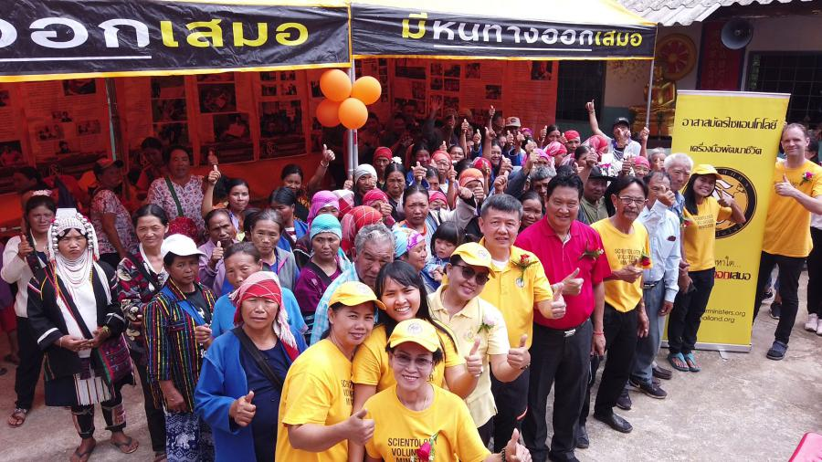 Scientology Volunteer Ministers Goodwill Tour is welcomed to the mountain village of Mae Salong, Thailand.