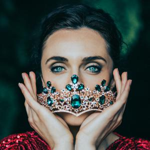 EMPRESS hold her crown, adorned in emeralds that highlight her stunning green eyes.