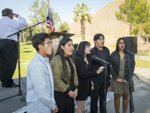 Local high school students performed the national anthem.