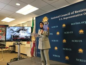 Soona Samsami releasing NCRI-US 60-page report on Iran uprising as she displays it