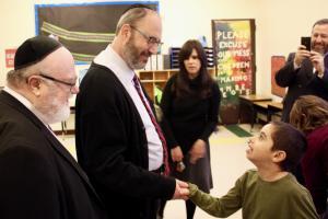 Dr. Joshua Weinstein, State Senator Felder greeting students