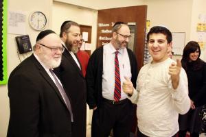 Dr. Joshua Weinstein, Ezra Friedlander, State Senator Felder greeting students