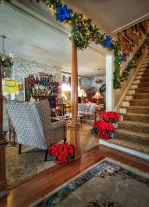 Holden House guests are welcomed into the foyer with the twinkle of lights, garlands and fireplace adorned with nutcrackers.