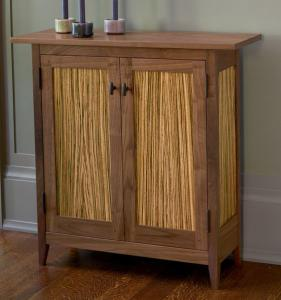 The expert craftsmanship and Shaker-inspired design of this cabinet accentuate the stunning natural grain of walnut and zebrawood.