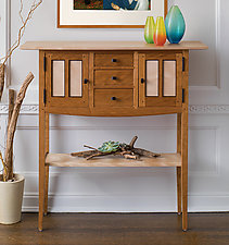 Dumke's signature blend of fine craftsmanship and meticulous detailing, in an elegant statement-making console.