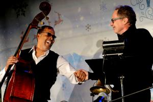 Stanley Clark and Mark Isham on the stage at Winter Wonderland, organized by the Church of Scientology Kansas City