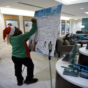 Over 100 kids signed the pledge to live drug-free for good at the Christmas Village Party on December 22nd. Shown here is a young man in the Foundation for a Drug-Free World Florida center, one of the 8 humanitarian centers participating in the Christmas Village event.