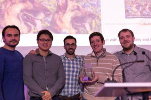 Four male developers holding a trophy