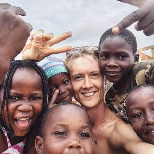 Skipper surrounded by happy children during his time in Mozambique where he helped to build a skatepark.