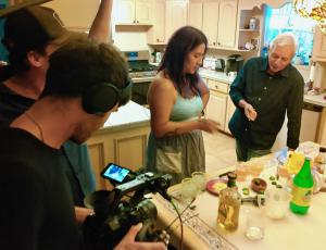 """Film crew taping visual artist, Celeste De Luna, with author Adán Medrano in a scene from new indie documentary, """"Texas Mexican Food Stories."""""""