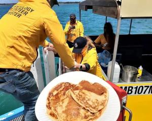 The Volunteer Ministers cooked banana pancakes on the bright yellow BBQ boat.