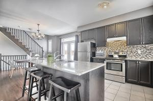 The bright, open concept kitchen and dining room