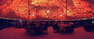 pole tent rental, decorated with light patterns