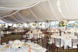 Frame tent rental, decorated with draping white fabrics