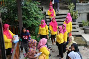 Newly trained Volunteer Ministers in their yellow T-shirts