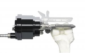 OMNIBotics robotic cutting guide, mounted to the femur.