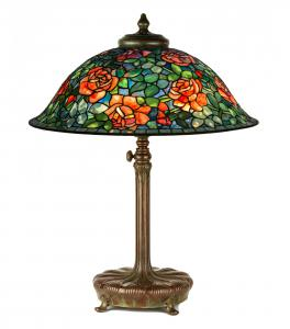 "Fine and rare Tiffany Studios (N.Y.) ""Rose"" table lamp, circa 1914, leaded glass and patinaed bronze, shade and base both Tiffany Studios impressed (est. $75,000-$125,000)."