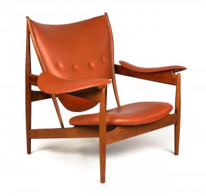 "Finn Juhl (Danish, 1912-1989) teak ""Chieftain Chair"" circa 1950, manufactured by Niels Vodder, from the estate of Inger-Marie Tanier and George Tanier (est. $15,000-$25,000)."