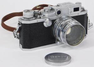 Canon Model IV S 35mm SLR camera, circa 1952-1953, including neck strap, skylight filter and lens cap, plus one Serenar 50mm f/1.8 lens (est. $300-$500).