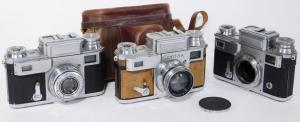Group of three Zeiss Ikon Contax III 543/24 35mm rangefinder cameras. Includes one fitted leather case and three Carl Zeiss lenses (est. $300-$600).