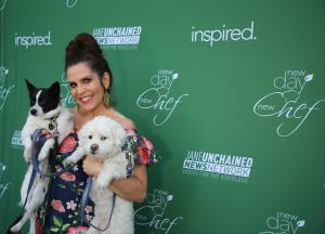 Lori Alan poses with her rescue dogs at the plant-based cooking show party featuring vegan recipes and vegan chefs