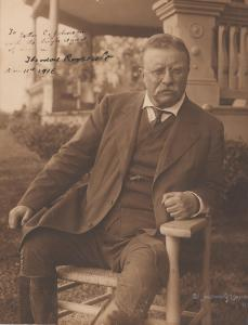 Signed photo of Theodore Roosevelt, post-presidency, showing him with a look of grim determination, 10 ¼ inches by 13 ½ inches, signed and inscribed (est. $2,400-$2,600).