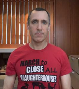 animal rights activist Donny Moss wears a t-shirt messaging slaughterhouses and the coronavirus