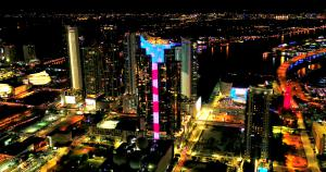Coronavirus Crisis: Paramount Miami Worldcenter Tower Shines Stars & Stripes As Patriotic Salute to Public Servants