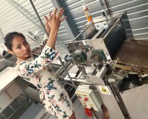 "Karla Plancarte explains the tortilla-making machinery in her warehouse at ""Tortillería Taiyari"""