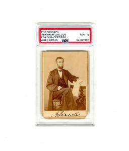 "Carte de visite portrait photograph of Abraham Lincoln dated Aug. 9, 1863, signed (as ""A. Lincoln"") and authenticated, slabbed and graded Mint 9 by PSA (est. $55,000-$60,000)."