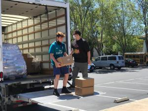 Volunteers unload more supplies from a truck