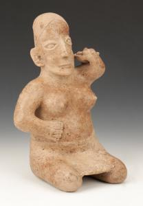 Pre-Columbian Jalisco Pottery Seated Female Figure. Ameca style, 200 BCE - 200 CE. Provenance: The Miles and Shirley Fiterman Collection, Minneapolis, MN. Size: 13.5'' x 8.5'' x 7'' (34 x 22 x 18 cm)