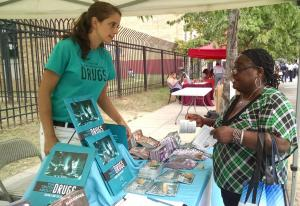 """Thalia Ghiglia, DFW DC Coordinator, sharing drug prevention materials at a 2019 """"Beat the Streets"""" event."""