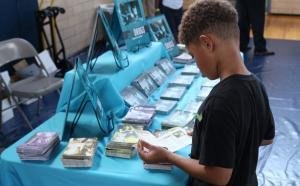 Young man reading the DFW Synthetics booklet
