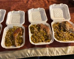 3 Styrofoam boxes of spiced rice and chicken