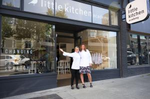 Iron Chef Cat Cora with Little Kitchen Academy founder standing outside in front of the flagship location in Vancouver, BC