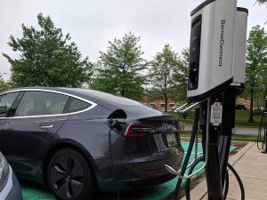 SemaConnect Series 5 smart EV charging stations charging a Tesla