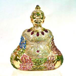 Judith Lieber Buddha minaudière, the interior lined in metallic leather, with tuck away gold tone shoulder chain, comb and mirror, and applied factory label, 5 ½ inches tall (est. $800-$1,200).