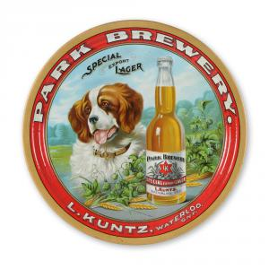 Kuntz tin lithographed beer tray made in Canada and featuring a St. Bernard dog graphic, highly detailed, 13 inches in diameter, with exceptional color and gloss (est. CA$6,000-$7,000).