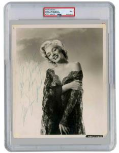 Signed publicity still of Marilyn Monroe from the 20th Century Fox movie How to Marry a Millionaire, PSA/DNA slabbed and graded NM-7 (est. $12,000-$14,000).