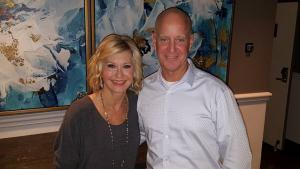 Olivia Newton-John is a big fan of Steve's and the show Flip or Flop; here Steve is with her backstage at one of her concerts he was invited to attend.