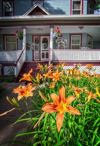 Holden House shares beautiful gardens with guest to the bed and breakfast inn